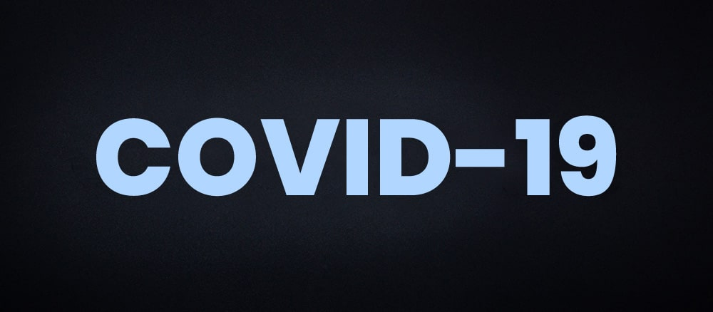 image of COVID-19 text on black background