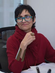 photo of Evelyn Morffi sitting in her office, smiling