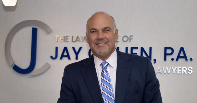 Jay Cohen standing at reception desk
