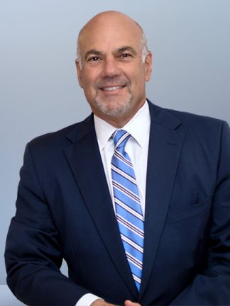 Jay Cohen Florida Attorney - leaning, blue background - image