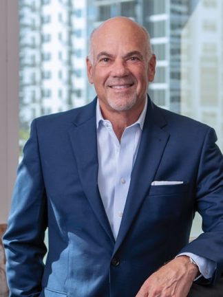 Jay Cohen Florida Attorney - half portrait leaning behind office chair