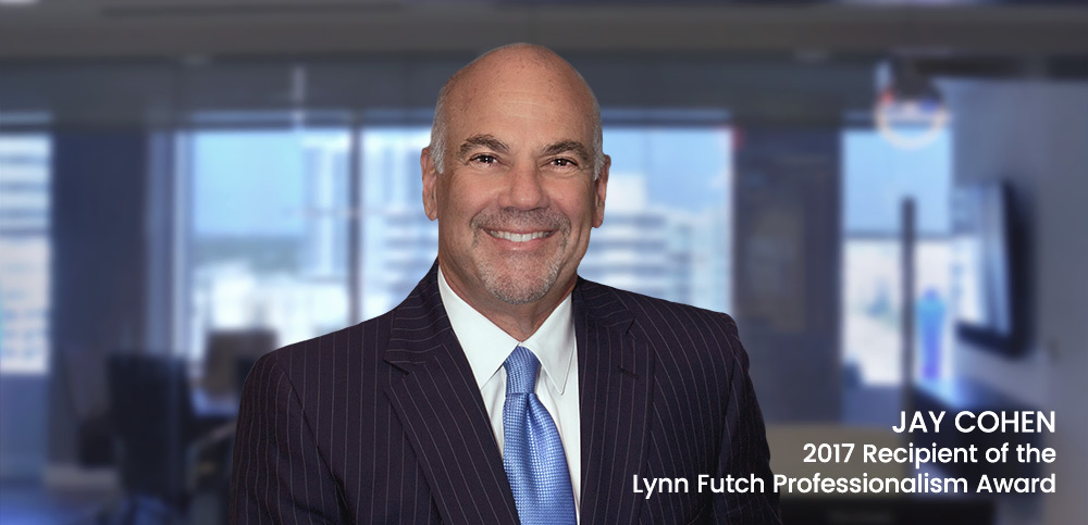 """portrait of Jay Cohen standing in front of blurred conference room, text overlay: """"2017 Lynn Futch Professionalism Award"""""""