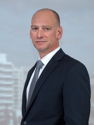 image of Jeff Blostein Florida Attorney - standing in front of window