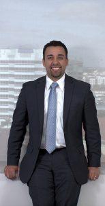 Rudwin Ayala Florida Attorney - standing against office window