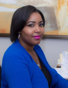 photo of Tiffany Jackson sitting at her desk, smiling