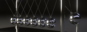 Monochrome image of silver Newton's cradle balls with dark background